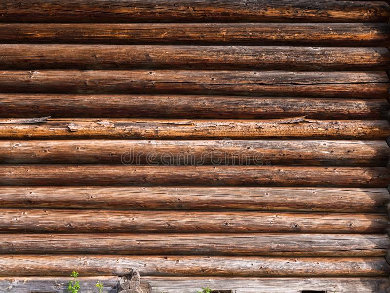 Log wall of rustic house. Wooden texture. Elements of an old rustic house made of wooden logs royalty free stock photography