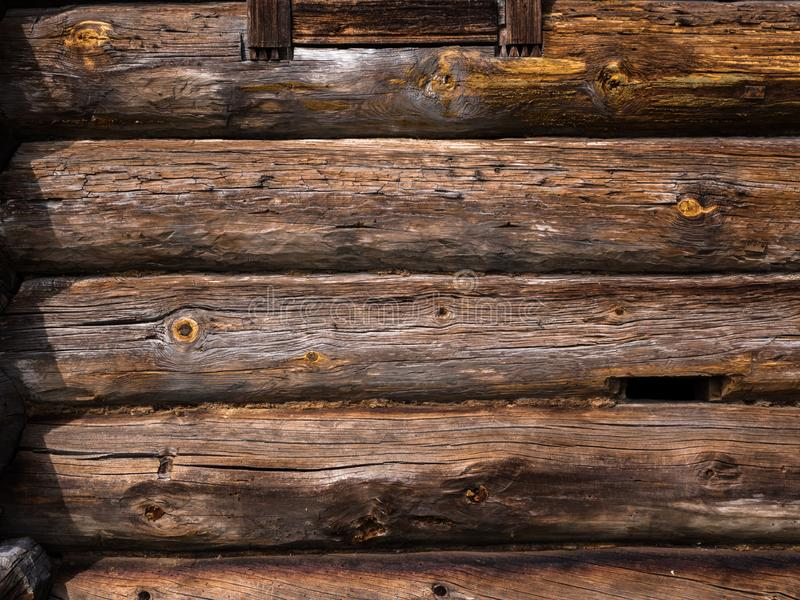 Log wall of rustic house. Wooden texture. Elements of an old rustic house made of wooden logs royalty free stock image