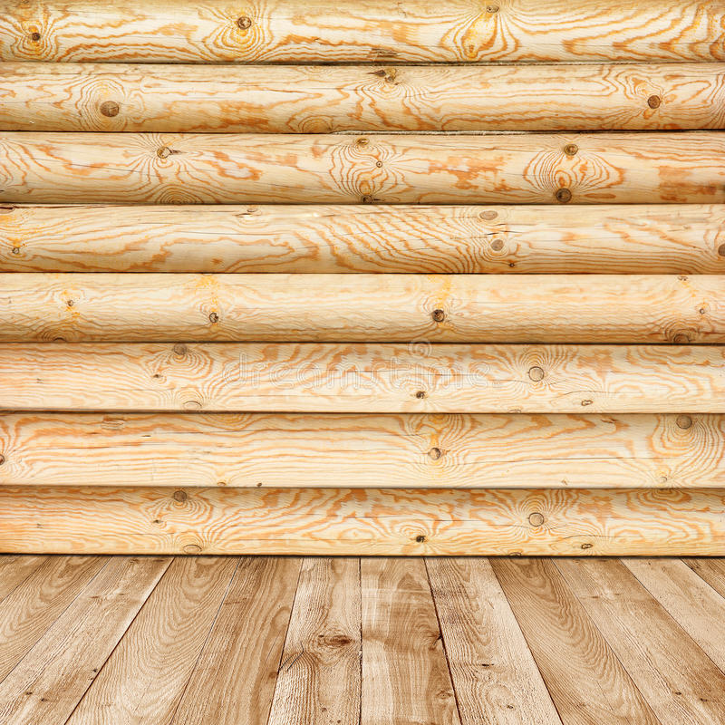 Log wall of yellow pine and wooden floor stock image