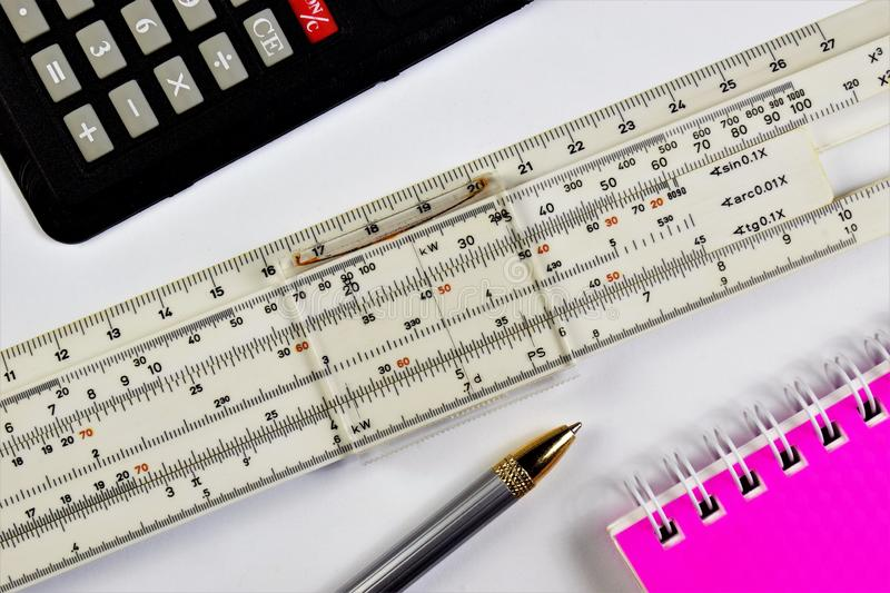 Logarithmic calculations at school in the classroom. The slide rule allows you to perform mathematical calculations, a calculator stock images