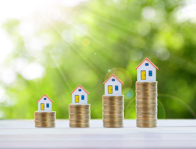 Logez le modèle et inventez l'argent, l'hypothèque et l'investissement immobilier photographie stock libre de droits
