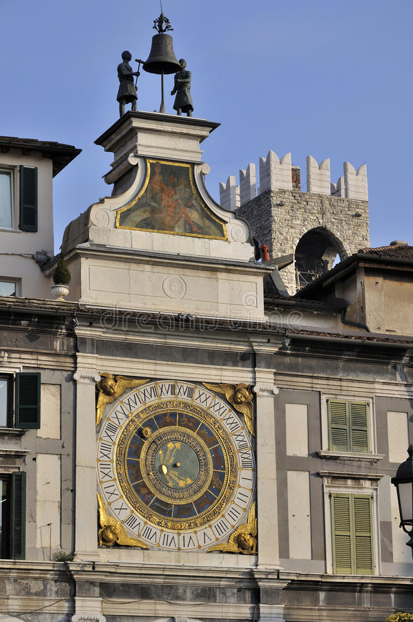 Loggia square wall clock, brescia. Ancient wall clock in the central square, famous also for the terrorist attack royalty free stock photo