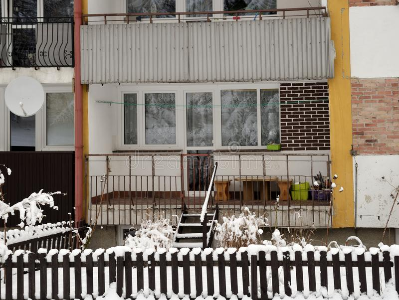 Loggias of apartment house with front garden in winter, Poland stock images