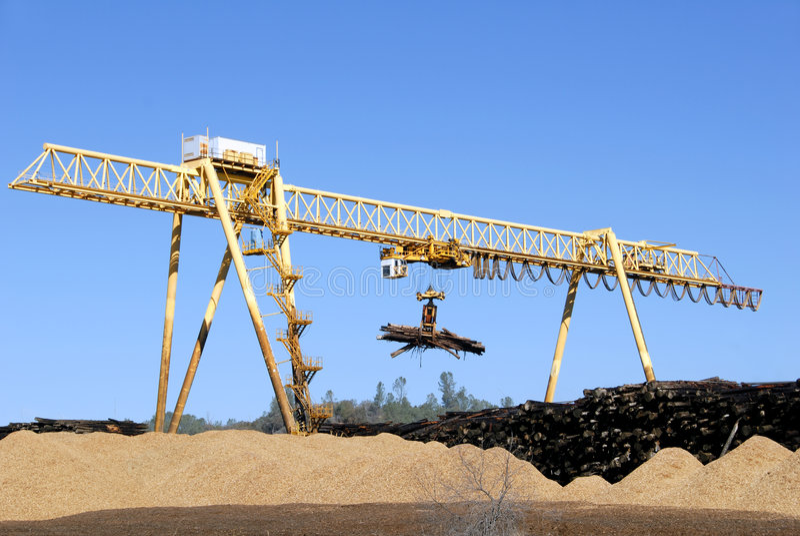 Logging Crane. Transporting Cut Logs royalty free stock photo