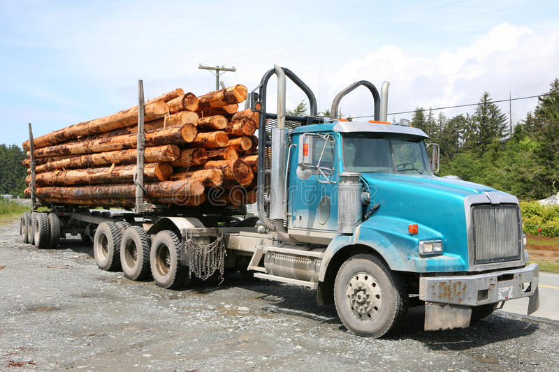 Logging truck. Parking logging truck next to a coastal road on vancouver island, canada stock image