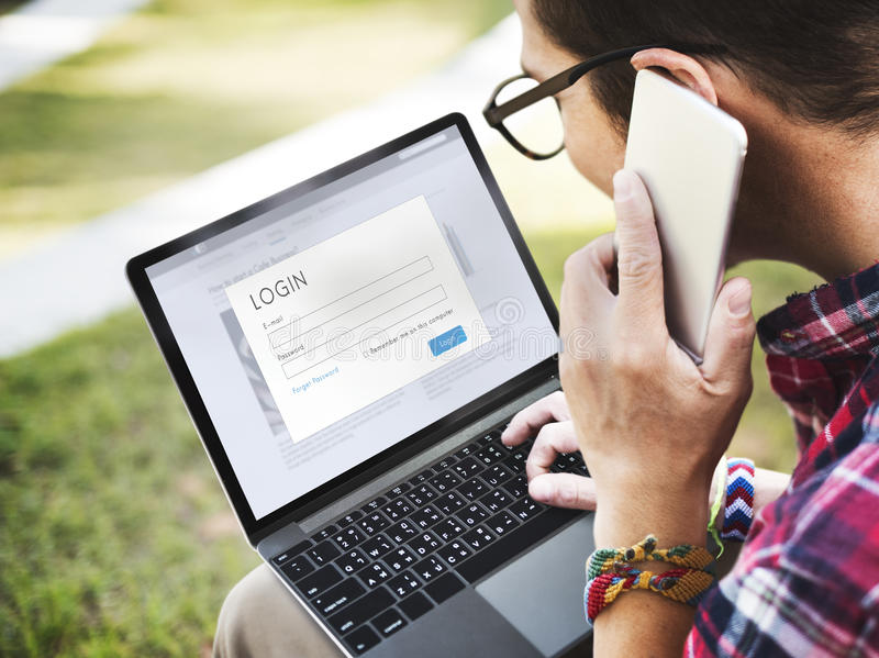 Login Password Online Security Computer Connection r Mobile Device Concept. Young Man Login Password Online Security Computer Mobile Device Connection royalty free stock image