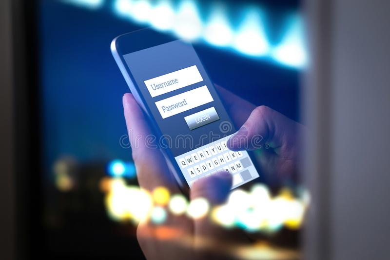 Login with smartphone to online bank account. Or personal information on internet at night. Hands typing and entering username and password to an application in royalty free stock image