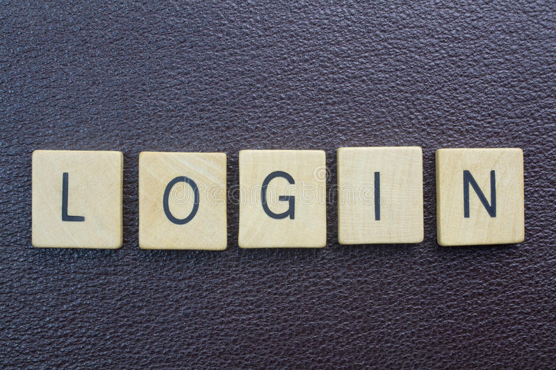 Login word - entry to website on internet. Ovehead photo of wood blocks spelling login royalty free stock photo