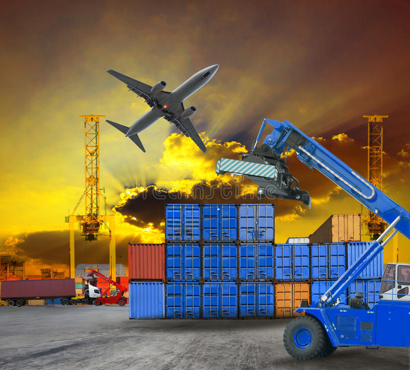 Logistic business working in container shipping yard with dusky sky and jet plane cargo flying above use for land to air transport. Working man in logistic royalty free stock photography
