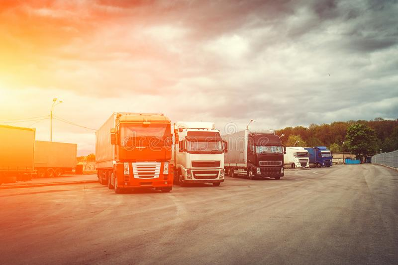 Logistic and transport concept, Container trucks for cargo delivery at sunset time, industrial transportation shipping royalty free stock photography
