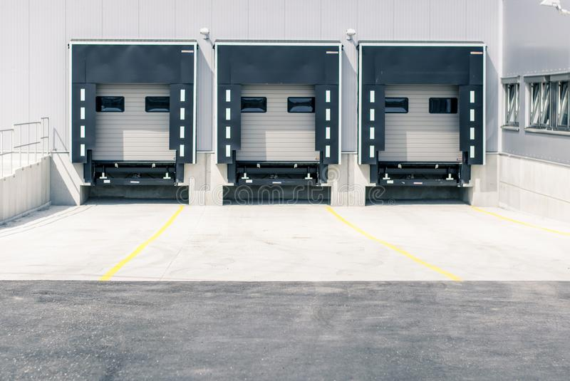 Logistics, parking, loading ramps. Logistics, parking lots, loading ramps on the back of the warehouse stock photo