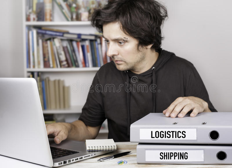 Logistics and Shipping - two folders on office desk. Man workin. G on notebook stock photo