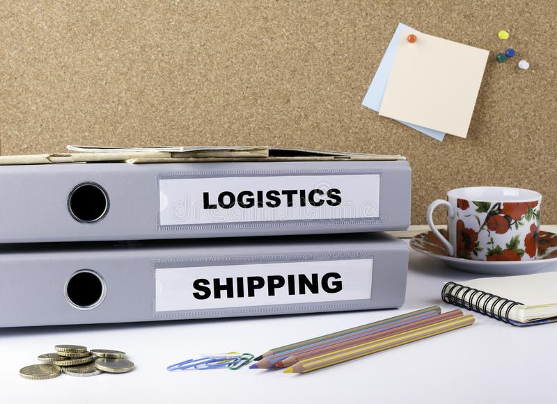 Logistics and Shipping - two folders on white office desk.  royalty free stock images
