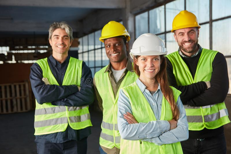 Logistics team with crossed arms. Logistics worker team with crossed arms in an industrial warehouse stock photography