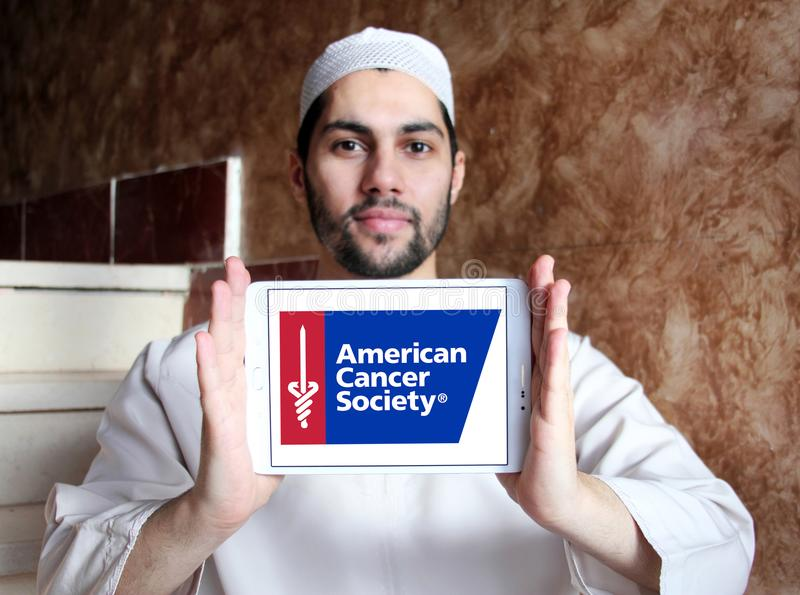 American Cancer Society , ACS, logo. Logo of American Cancer Society , ACS, on samsung tablet holded by arab muslim man. The American Cancer Society ACS is a royalty free stock images