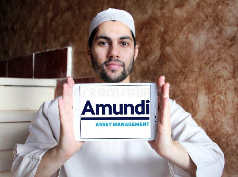 Amundi asset management company logo. Logo of Amundi asset management company on samsung tablet holded by arab muslim man royalty free stock images