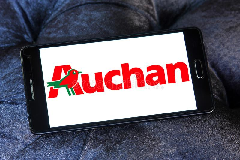 Auchan retail group logo. Logo of Auchan retailer on samsung mobile. Auchan is a French international retail group and multinational corporation royalty free stock photos
