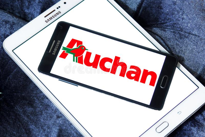 Auchan retail group logo. Logo of Auchan retailer on samsung mobile. Auchan is a French international retail group and multinational corporation stock photo