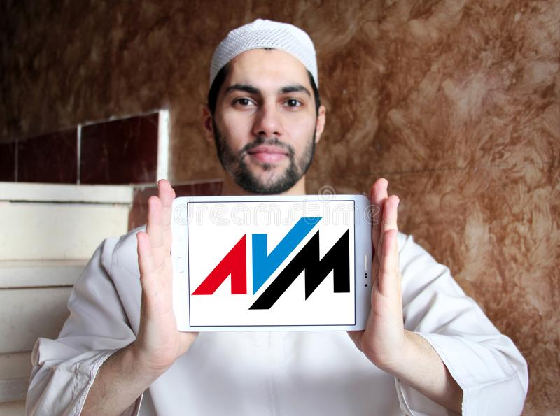 AVM electronics company logo. Logo of AVM electronics company on samsung tablet holded by arab muslim man. AVM is a consumer electronics company. The company stock photography