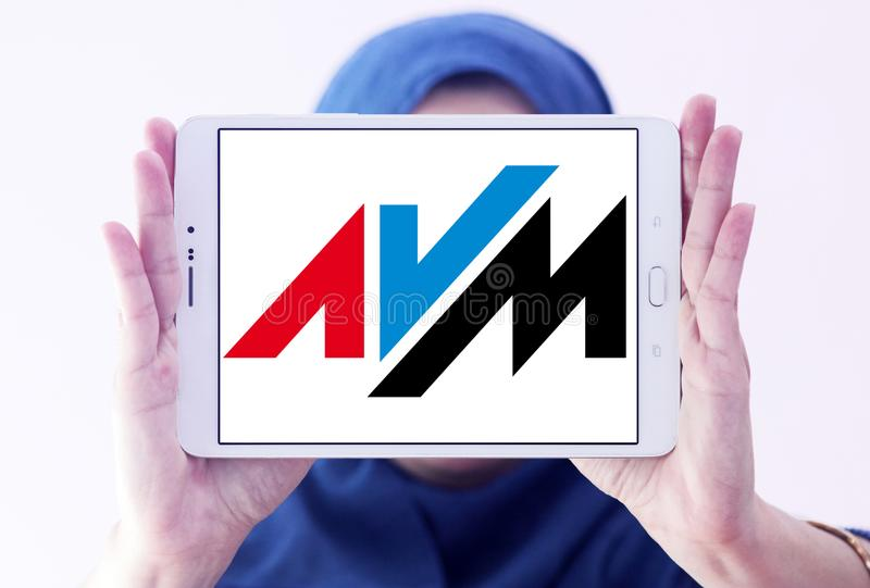 AVM electronics company logo. Logo of AVM electronics company on samsung tablet holded by arab muslim woman. AVM is a consumer electronics company. The company stock image