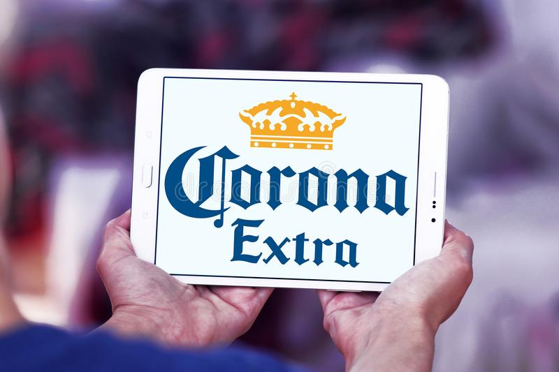 Corona extra beer logo. Logo of Corona extra beer on samsung tablet. Corona Extra is a pale lager produced by Cervecería Modelo in Mexico for domestic stock photos