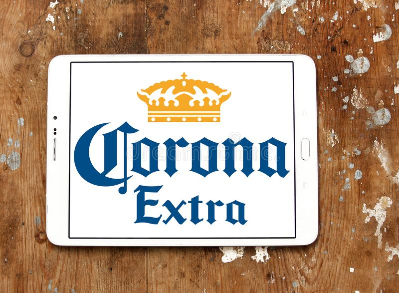 Corona extra beer logo. Logo of Corona extra beer on samsung tablet on wooden background. Corona Extra is a pale lager produced by Cervecería Modelo in Mexico stock photos