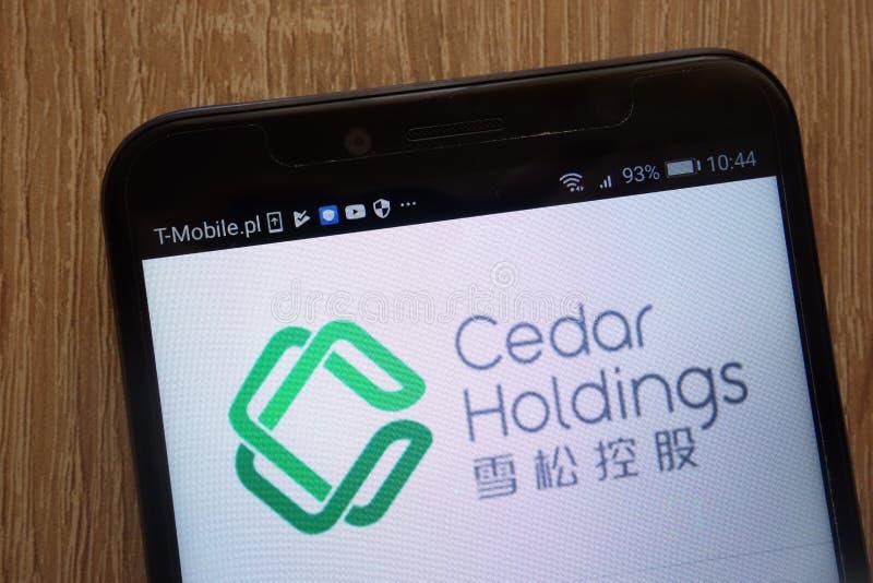 Logo de Cedar Holdings montré sur un smartphone moderne photographie stock libre de droits