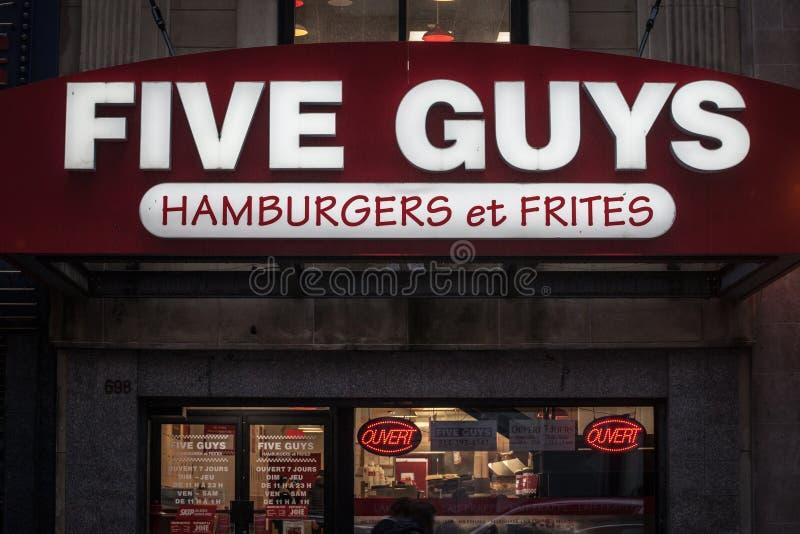 Logo de cinq types sur leur restaurant principal d'aliments de préparation rapide pour Montréal, Québec, iwith leur slogan en fra image stock