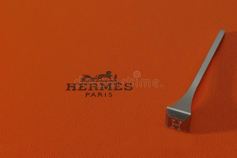 Logo di Hermes e chiodo del ferro di cavallo - concetto di lusso fotografia stock