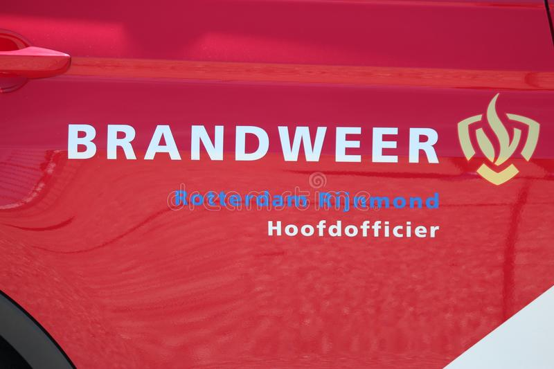 Logo of the dutch fire fighters brigade in the Netherlands with name Brandweer in dutch of the Rotterdam Brigade in the car of th royalty free stock photo
