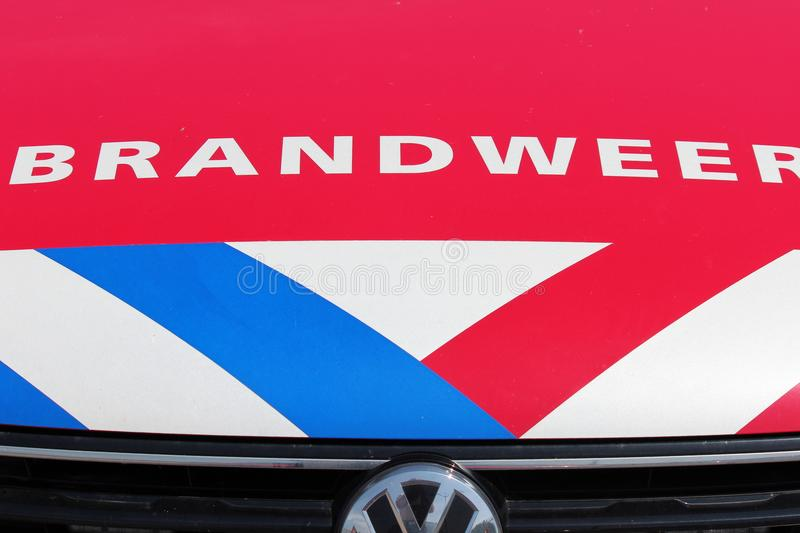 Logo of the dutch fire fighters brigade in the Netherlands with name Brandweer in dutch and the red,white blue striping on red ca stock photography