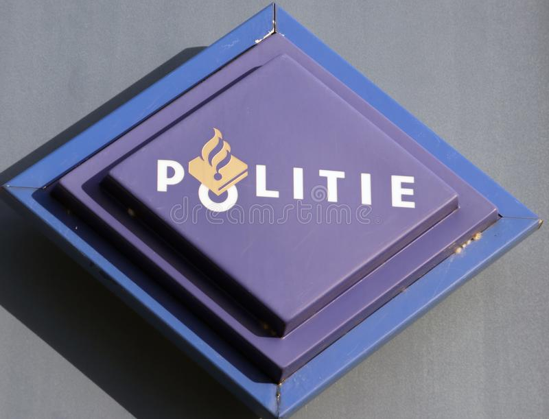Logo of the dutch police force named Politie in a rectangle in blue on station in the Netherlands.  stock photography