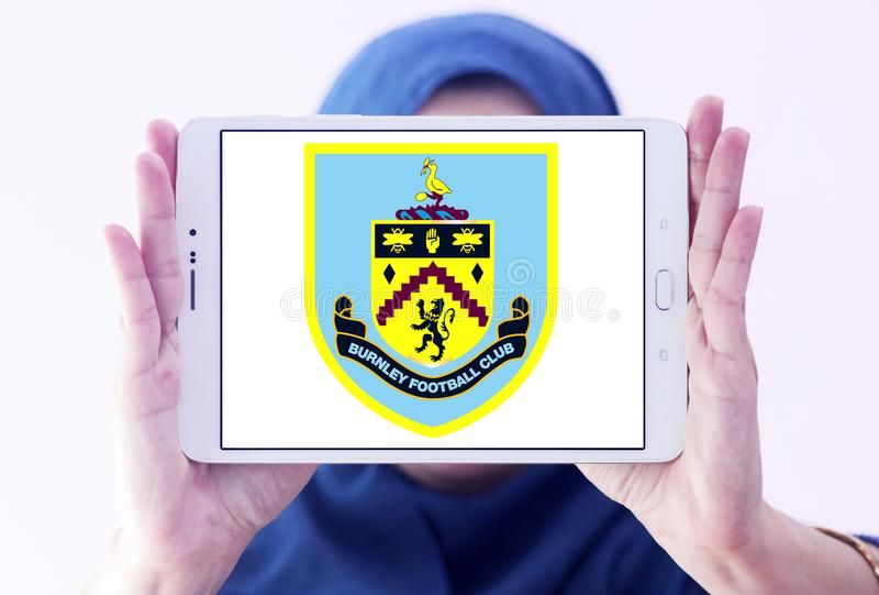 Burnley F.C. soccer club logo. Logo of english Burnley F.C. soccer club on samsung tablet holded by arab muslim woman royalty free stock photos