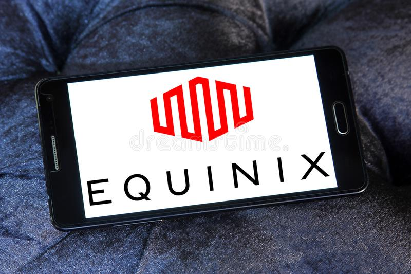 Equinix internet company logo. Logo of Equinix internet company on samsung mobile. Equinix, Inc. is an American multinational company that specializes in royalty free stock photo
