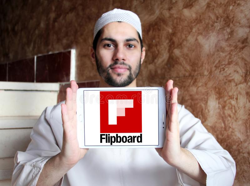 Flipboard logo. Logo of Flipboard on samsung tablet holded by arab muslim man. Flipboard is a news aggregation and social network aggregation company. It stock image