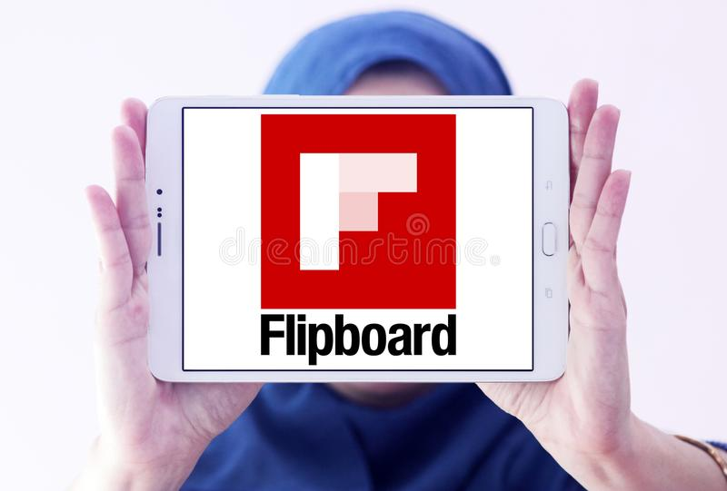 Flipboard logo. Logo of Flipboard on samsung tablet holded by arab muslim woman. Flipboard is a news aggregation and social network aggregation company. It stock image