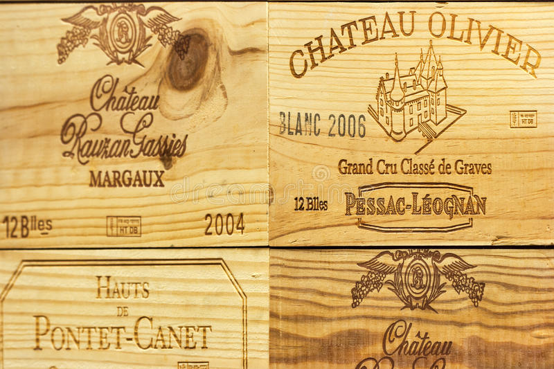 Logo of French winery Chateau Olivier on wooden wine box. Corporate logo of the famous French winery Chateau Olivier and others on wooden wine boxes closeup. It royalty free stock photography
