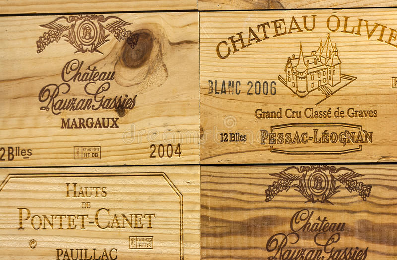 Logo of French winery Chateau Olivier on wooden wine box. Corporate logo of the famous French winery Chateau Olivier and others on wooden wine boxes closeup. It stock photos