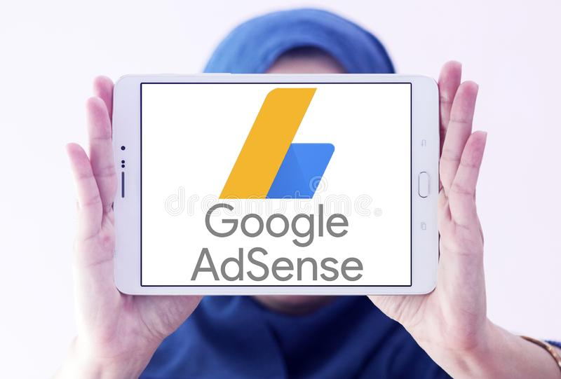 Google AdSense logo. Logo of Google AdSense on samsung tablet holded by arab muslim woman . Google AdSense is a program run by Google that allows publishers in royalty free stock images