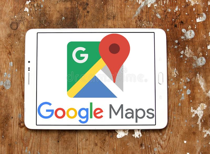 Google Maps logo. Logo of Google Maps on samsung tablet on wooden background. Google Maps is a web mapping service developed by Google. It offers satellite royalty free stock photos