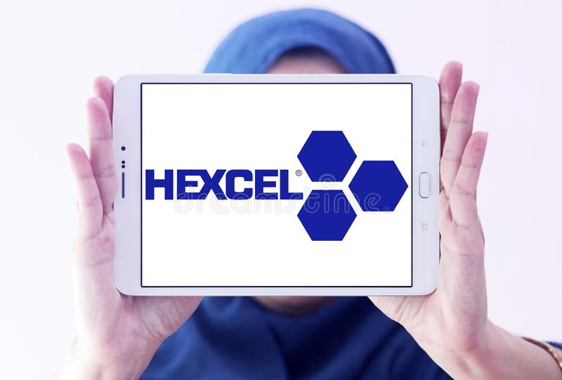 Hexcel Corporation logo. Logo of Hexcel Corporation on samsung tablet holded by arab muslim woman. Hexcel is a public company that produces advanced composite stock photography