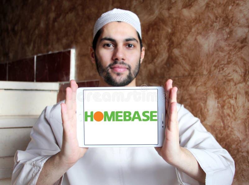 Homebase retailer logo. Logo of Homebase retailer on samsung tablet holded by arab muslim man. Homebase is a British home improvement retailer and garden centre stock image