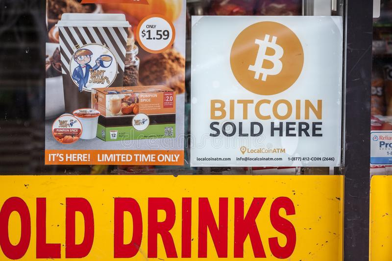 Logo indicating a Bitcoin ATM in a convenience store, from Local Coin ATM. TORONTO, CANADA - NOVEMBER 14, 2018: Bitcoin is a cryptocurrency available for buying stock photo
