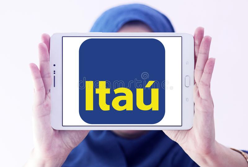 Itau Unibanco bank logo. Logo of Itau Unibanco bank on samsung tablet holded by arab muslim woman. Itaú Unibanco is a Brazilian publicly quoted bank. it is stock image