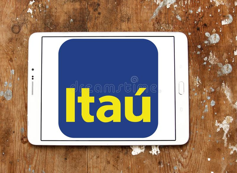Itau Unibanco bank logo. Logo of Itau Unibanco bank on samsung tablet on wooden background. Itaú Unibanco is a Brazilian publicly quoted bank. it is the royalty free stock photos