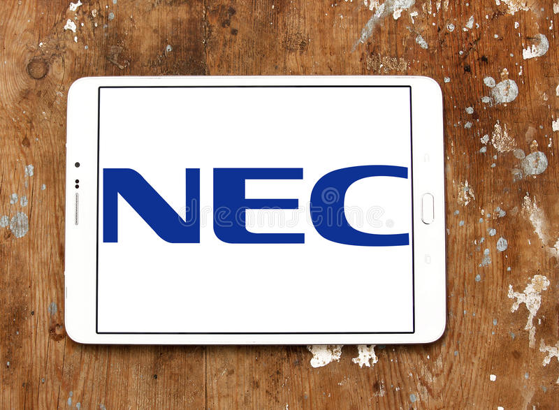 NEC Corporation logo. Logo of NEC Corporation on samsung tablet on wooden background. NEC Corporation is a Japanese multinational provider of information stock images