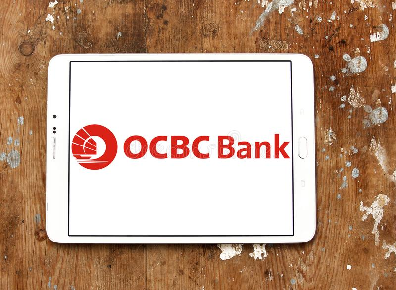 OCBC Bank logo. Logo of OCBC Bank on samsung tablet. OCBC Bank is a publicly listed financial services organisation stock photography