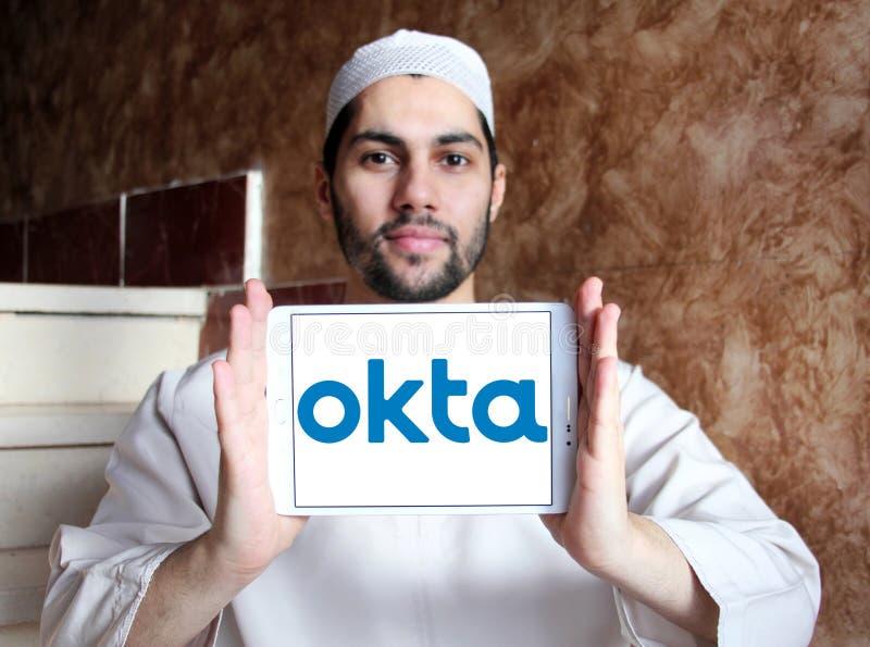 Okta company logo. Logo of Okta company on samsung tablet holded by arab muslim man. Okta is a publicly traded identity management company. It provides cloud stock photo