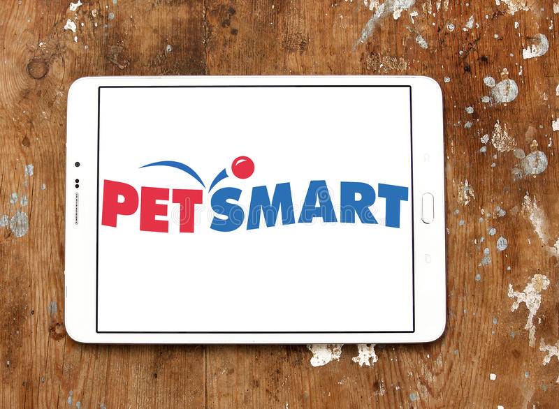 PetSmart retailer logo. Logo of PetSmart on samsung tablet on wooden background. PetSmart is an American retail chain operating in the United States, Canada, and stock image