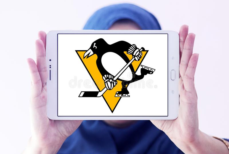 Pittsburgh Penguins ice hockey team logo. Logo of Pittsburgh Penguins ice hockey team on samsung tablet holded by arab muslim woman. The Pittsburgh Penguins are royalty free stock images
